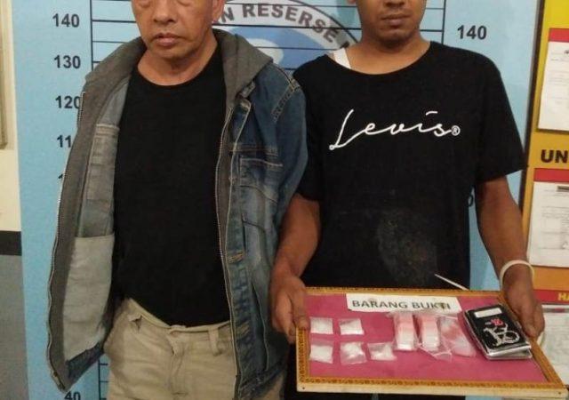 MUN, 30, oknum guru olahraga salah satu SMK Aceh Utara, dan TAR,45, yang ditangkap Polres Aceh Utara. Mereka saat ini, ditahan di rutan Mapolres Aceh Utara untuk proses penyelidikan dan penyidikan lebih lanjut. (Foto/Ist)