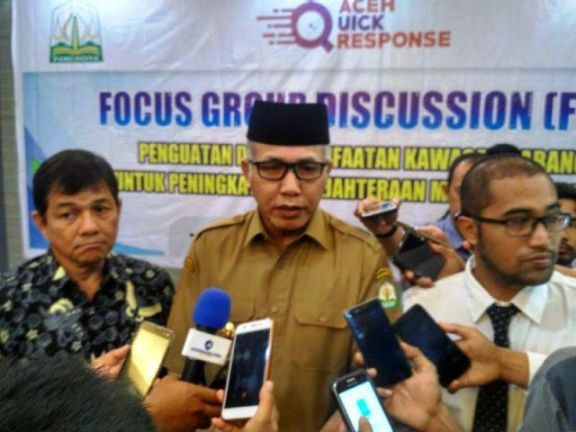 Plt Gubernur Aceh, Nova Iriansyah, dan tampak Kepala BPKS, Sayid Fadhil, pada FGD bertema Penguatan dan Pemanfaatan Kawasan Sabang untuk Peningkatan Kesejahteraan Masyarakat, Senin (17/12/2018). (Foto/Ist)